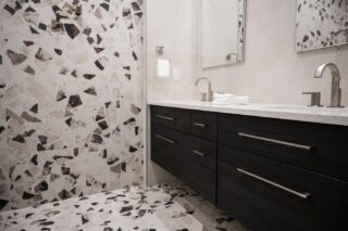 With speckled good looks, terrazzo is a durable option for this spa-ish bathroom. This large scaled Terrazzo tile is made out of chips of marble, and stone. It's texture alone is luxurious underfoot. Design:@michelealfanodesign #poeticmodernism® #terrazzo #bathroom #modern @pyramidplumbing @brizofaucet @kjtilesco Photo: @vcapturephotography