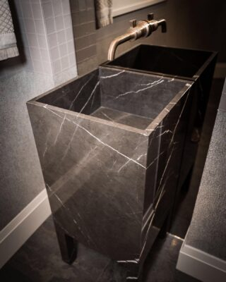 A stone sink on trough legs evokes that oooh! A wonderful surprise to this powder room design by @michelealfanodesign, #thepoeticmodernist.  The beauty is in the details of the veining. Fabrication by @imperial_marble_ny_nj . Photo credit @vcapturephotography #poeticmodernism® #bathroom #stone #modern